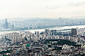 The panoramic view from the Seoul Tower over looks the city from atop of a tall mountain in the center of the city. Miles can be seen from the vantage point.