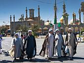 Chatting mullahs against the minarets of the Hazrat-e Masumeh (Holy Shrine), Qom, Iran, Middle East