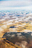 Aerial view of ponds dotting the tundra landscape, thin clouds above the land, Barrow, North Slope, Alaska, United States of America