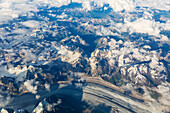 Aerial view of clouds twisting among the snowy peaks of the Alaska Range, interior Alaska, Alaska, United States of America