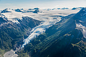 Aerial view of a glacier decends from the Harding ice field into a green valley on the Kenai Peninsula, Seward, Alaska, United States of America