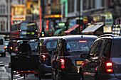 Taxis and traffic on Shaftsbury Avenue, London, England