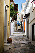 A narrow alley between houses on a greek island, Panormos, Thessalia Sterea Ellada, Greece