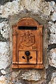 An old mailbox in a weathered stone wall, Capri, Campania, Italy