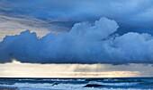 Stormy sunset over a west coast sea, Greymouth, South Island, New Zealand