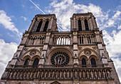 The bell towers of Notre Dame de Paris against a bright spring sky, Paris, France