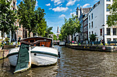 view over the Groenburgwal and the Christ Church of Amsterdam, Netherlands