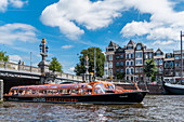 tourist boat on the Amstel in Amsterdam, Netherlands
