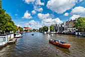 Tourist boats on the Amstel of Amsterdam, Netherland