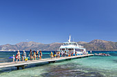 Ferry from Saint-Florent arriving on beach Plage de Loto in the Desert of Agriates, Corsica, Southern France, France, Southern Europe