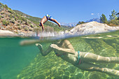 Young woman in a swimming spot in river Fango near Galeria, Corsica, Southern France, France, Southern Europe
