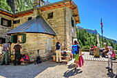 Several persons standing on terrace of hut Rifugio Treviso Val Canali, Val Canali, Pala Group, Dolomites, UNESCO World Heritage Site Dolomites, Trentino, Italy
