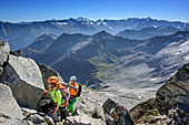 Man and woman climbing on fixed-rope route towards Richterspitze, Richterspitze, Reichenspitze group, Zillertal Alps, Tyrol, Austria