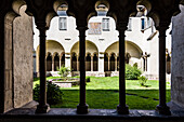 View from the cloister to the inner courtyard in the Franciscan cloister, Bolzano, South Tyrol, Italy