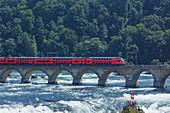 Train on bridge over remote river