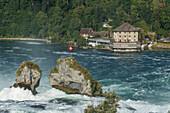 House on rocky river