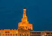 Islamic Cultural Center spire illuminated at night, Doha, Qatar