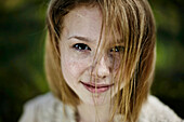 Smiling Caucasian girl with freckles