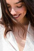 Hispanic woman smiling in wind