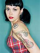 Woman with tattoos wearing retro dress