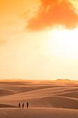 Hikers walking in remote desert