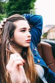 Caucasian woman sitting in convertible