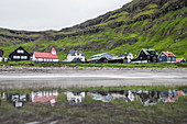 Little village with typical colored houses at the sea, Faeroe Islands