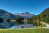 Mountainbiker at Lake Champfer with Silvaplana and Piz da la Margna, Champfer, Engadine, Canton Grisosn, Switzerland