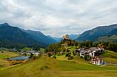 View at Tarasp with Tarasp castle, Engadine, Canton Grisons, Switzerland