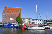 Sailing boats in harbour in front of old storage building, Hanseatic City Stralsund, Baltic Sea coast, Mecklenburg-Western Pomerania, Northern Germany, Germany, Europe