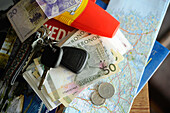 Table with car keys, Swedish money and road map, Travel