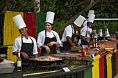 Cheerful chefs during Friday evening Beach BBQ at Sunrise Beach of Half Moon Resort Rose Hall, near Montego Bay, Saint James, Jamaica