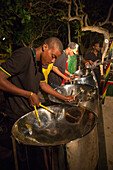 Steel band plays during Friday evening Beach BBQ at Sunrise Beach of Half Moon Resort Rose Hall, near Montego Bay, Saint James, Jamaica