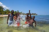 Splashing guides of Half Moon Resort horseback ride excursion in Caribbean Sea Rose Hall, near Montego Bay, Saint James, Jamaica