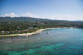 Aerial of coastline and Half Moon Resort seen from parasail Rose Hall, near Montego Bay, Saint James, Jamaica