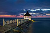 Jetty with pavillion at Half Moon Resort at dusk Rose Hall, near Montego Bay, Saint James, Jamaica