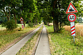 avenue of trees, rail crossing signs, country path, Mecklenburg-Vorpommern, Germany
