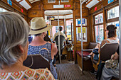 interior of tram, passengers, Lisbon, tourist attraction, Portugal