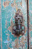hand door-knocker on weathered door, peeling paint, nobody, Lisbon, Portugal