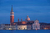 Views over the Venice Lagoon on the island of San Giorgio Maggiore with its eponymous Benedictine abbey and church in the blue of the night, San Marco, Venice, Veneto, Italy