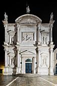 Illuminated facade of Church of San Rocco in the night, San Polo, Venice, Veneto, Italy