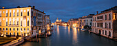 Panoramic view from the Ponte dell'Accademia over the Grand Canal with illuminated houses, the Palazzo Cavalli-Franchetti left, the Palazzo Contarini Polignac right and the church of Santa Maria della Salute in the background in the blue of the night, Dor