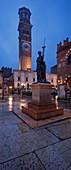 Market square Piazza delle Erbe in the old town of Verona with the bronze statue Civilta Italica and the Torre dei Lamberti, Veneto, Italy
