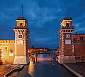 Arsenale di Venezia, the former shipyard and naval base in the blue of the night, with an illuminated wall  Ingresso All'Acqua, Venetian Arsenal, Castello, Venice, Veneto, Italy