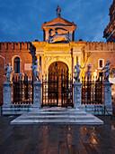 Arsenale di Venezia, the former shipyard and naval base in the blue of the night, with an illuminated wall and portal Ingresso di Terra, Venetian Arsenal, Castello, Venice, Veneto, Italy