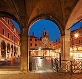 Overlooking the Campo San Giacomo di Rialto with archs, booths and the illuminated facade of the church Chiesa di San Giacomo di Rialto in blue at night, San Polo, Venice, Veneto, Italy