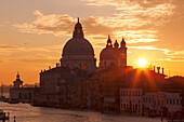 Sunrise above the Grand Canal with the church of Santa Maria della Salute, Dorsoduro, Venice, Veneto, Italy