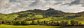 Panorama overlooking the hills of the Val d'Orcia and castle Castiglione d'Orcia with fields and forest in spring in the evening sun, Siena, Tuscany, Italy Province