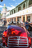 Art Deco Festival, vintage cars parked in front of Masonic Hotel Napier, Hawke's Bay, North Island, New Zealand