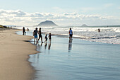 Mt Maunganui seen from Papamoa Beach, families, holiday beach, sand, horizon, surf beach, Tauranga, North Island, New Zealand